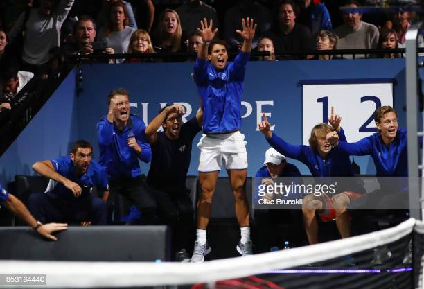 Rafael Nadal of Team Europe celebrates with Team Europe team mates during the mens singles match between Roger Federer and Nick Kyrgios of Team World...