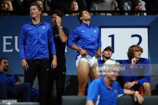 Rafael Nadal of Team Europe reacts with Team Europe team mates during the mens singles match between Roger Federer and Nick Kyrgios of Team World on...