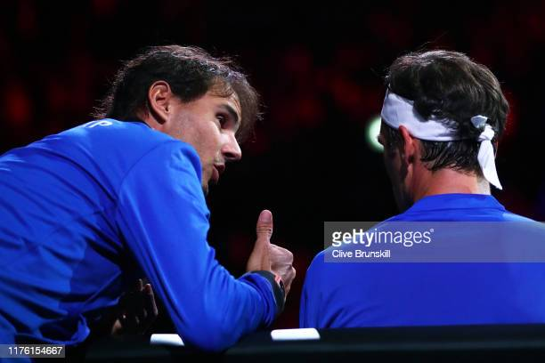 Rafael Nadal of Team Europe speaks to teammate Roger Federer as he sits down during his singles match against Nick Kyrgios of Team World during Day...