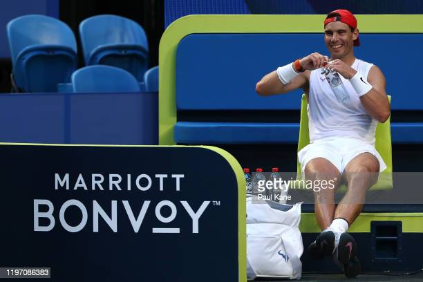 Rafael Nadal of Team Spain looks on during a practice session against Karen Khachanov of Team Russia ahead of the 2020 ATP Cup Group Stage at RAC...