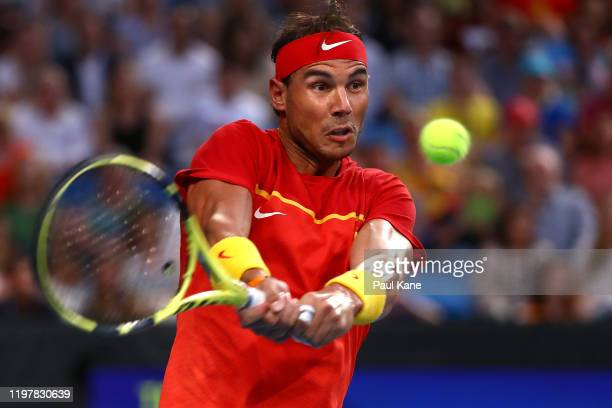 Rafael Nadal of Team Spain plays a backhand to Pablo Cuevas of Team Uruguay during day four of the 2020 ATP Cup Group Stage at RAC Arena on January...