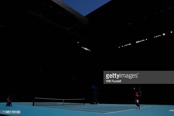 Rafael Nadal of Team Spain serves to Yoshihito Nishioka of Team Japan during day six of the 2020 ATP Cup Group Stage at RAC Arena on January 08, 2020...