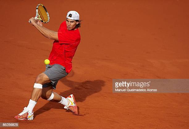 Rafael Nadal plays a backhand during a practice session in preparation for the Davis Cup World Group First Round tie between Spain and Serbia at the...