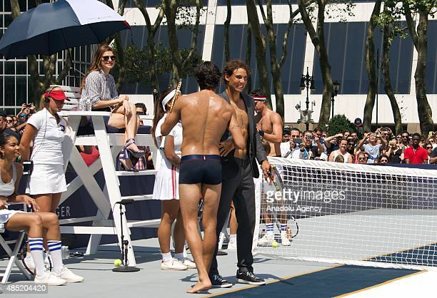 Rafael Nadal plays tennis with model Akin Akman during the brand event of Rafael Nadal Global Brand Ambassadorship Launch at Bryant Park on August 25...