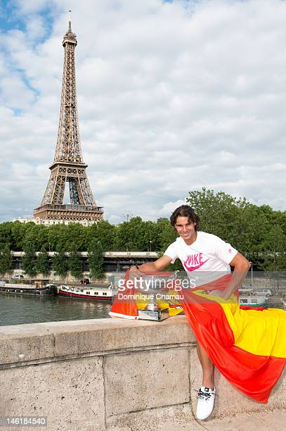 Rafael Nadal poses after his 7th victory at the French Open at Pont de BirHakeim on June 11 2012 in Paris France