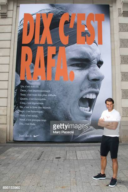 Rafael Nadal poses in front of a poster reading 'Ten It's Rafa' refering to his tenth win at the French Tennis Open during a promotional event at the...