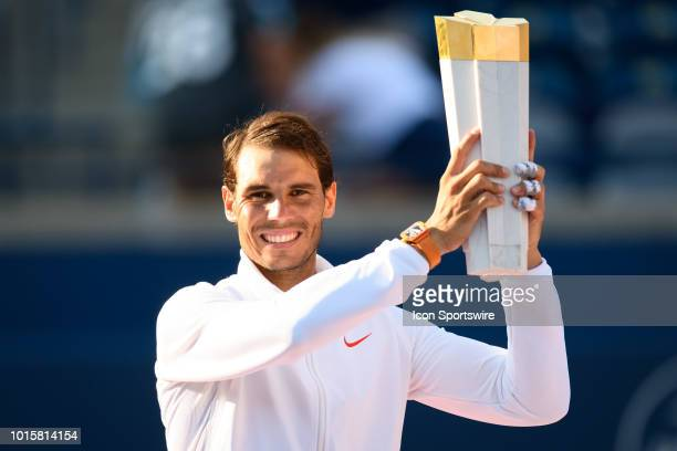Rafael Nadal poses with the championship trophy after winning the Rogers Cup tennis tournament Final on August 12 at Aviva Centre in Toronto ON Canada