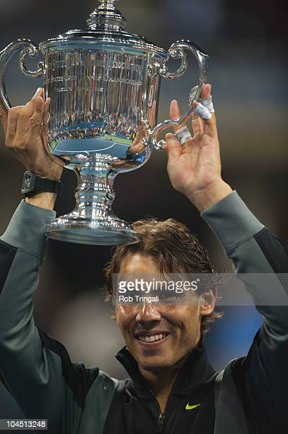 Rafael Nadal raises the US Open Trophy after defeating Novak Djokovic in the men's final on day fifteen of the 2010 US Open at the USTA Billie Jean...