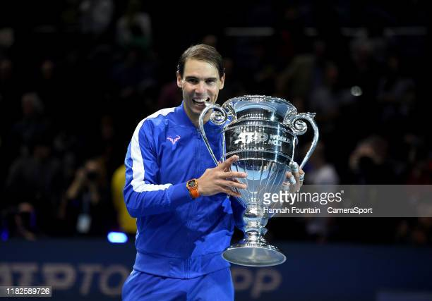 Rafael Nadal recieving his trophy after being announced as ATP Tour end of year world number one following his singles match against Stefanos...