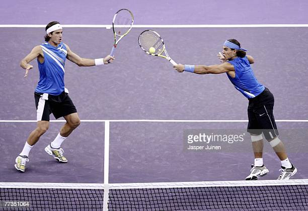 Rafael Nadal returns a backhand flanked by his double partner Feliciano Lopez during their ATP Masters Series tennis tournament match against...