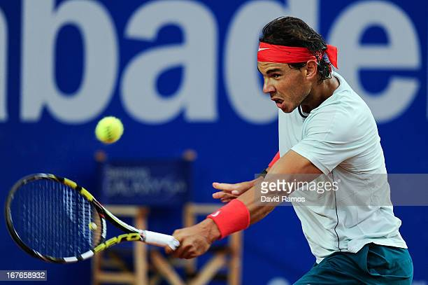 Rafael Nadal returns the ball to Milos Raonic of Canada during his semi-final match of day six of the 2013 Barcelona Open Banc Sabadell on April 27,...