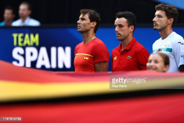 Rafael Nadal Roberto Bautista Agut and Pablo Carreno Busta of Team Spain stand for the national anthem during day four of the 2019 ATP Cup Group...