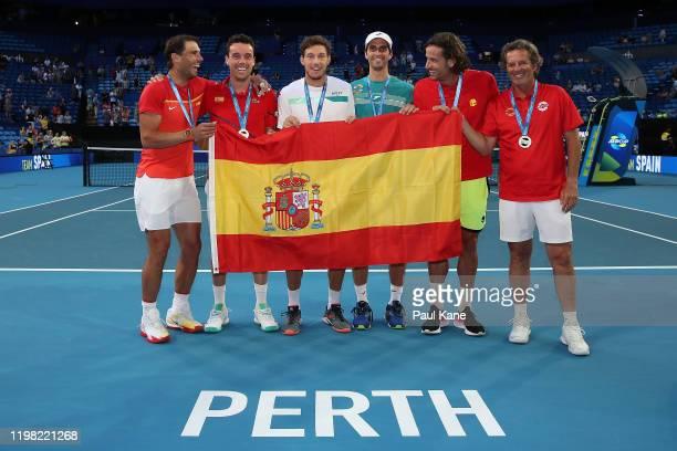 Rafael Nadal, Roberto Bautista Agut, Pablo Carreno Busta, Albert Ramos-Vinolas, Feliciano Lopez and Francisco Roig of Team Spain pose after winning...