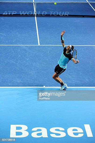 Rafael Nadal serves during a match against Grigor Dimitrov in the second round of the Swiss Indoors at St. Jakobshalle in Basel, Switzerland on...