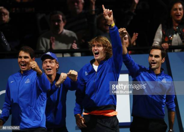 Rafael Nadal Tomas Berdych Alexander Zverev and Roger Federer of Team Europe celebrate as they watch the singles match between Dominic Thiem of Team...