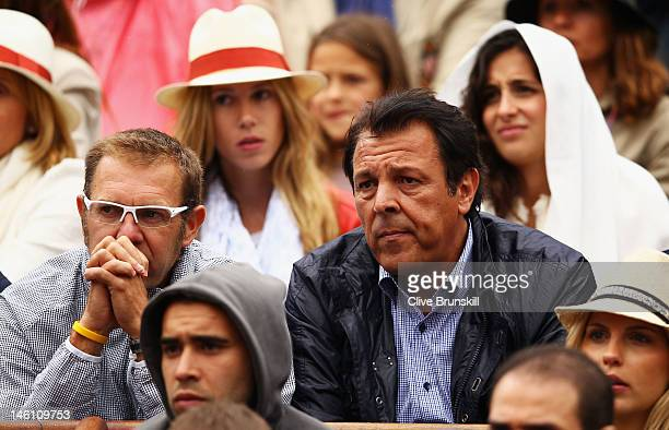 Rafael Nadal's father Sebastian Nadal watches the action in front of his sister Isabel Nadal and girlfriend Xisca Perello watch the men's singles...