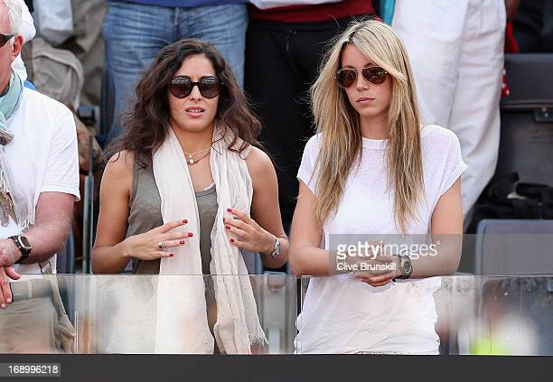 Rafael Nadal's girlfriend Maria Francisca Perello and his sister Isabel Nadal watch him play against Tomas Berdych of the Czech Republic in their...