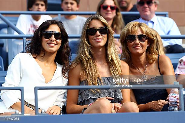 Rafael Nadal's girlfriend Maria Francisca Perello his sister Isabel Nadal and mother Ana María Parera look on from the stands prior to Nadal playing...