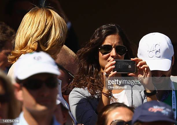 Rafael Nadal's girlfriend Maria Francisca Perello, 'Xisca' takes pictures of the prize ceremony watched by his mother Ana Maria Parera, after his...