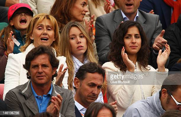 Rafael Nadal's mother Ana Maria Perera sister Isabel Nadal and girlfriend Xisca Perello applaud during the men's singles final between Novak Djokovic...