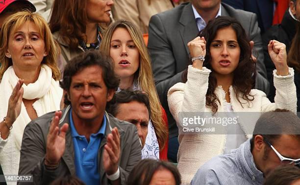 Rafael Nadal's mother Ana Maria Perera sister Isabel Nadal and girlfriend Xisca Perello cheer during the men's singles final between Novak Djokovic...