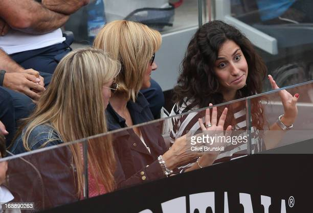 R Rafael Nadal's sister Isabel Nadal his mother Ana María Parera and girlfriend Maria Francisca Perello look on from the stands as he plays against...