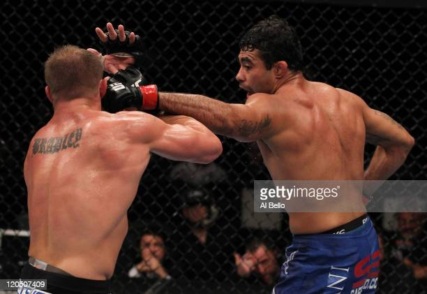 Rafael Natal punches Paul Bradley during a middleweight bout at UFC 133 at Wells Fargo Center on August 6, 2011 in Philadelphia, Pennsylvania.