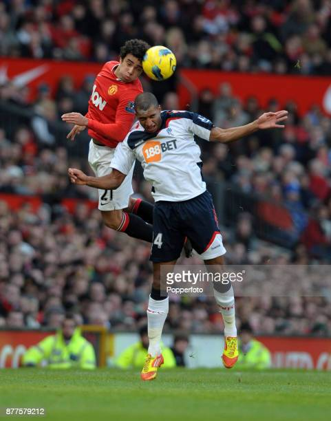 Rafael of Manchester United and David Ngog of Bolton Wanderers battle for the ball during a Barclays Premier League match at Old Trafford on January...