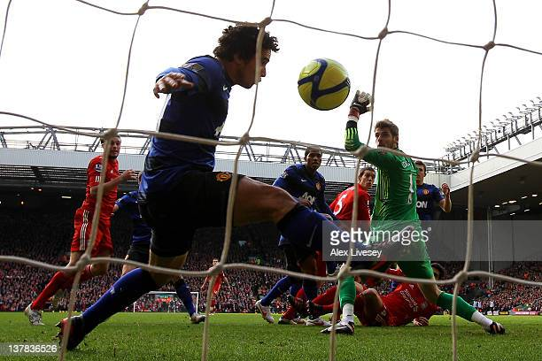 Rafael of Manchester United is unable to prevent Daniel Agger of Liverpool scoring the opening goal during the FA Cup Fourth Round match between...