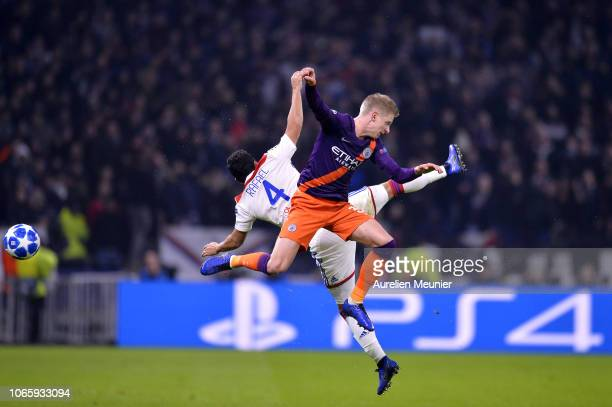 Rafael of Olympique Lyonnais and Oleksandr Zinchenko of Manchester City jump for the ball during the Group F match of the UEFA Champions League...