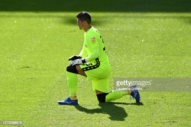 Rafael of Reading FC takes a knee in support of the Black Lives Matter movement prior to the Sky Bet Championship match between Derby County and...