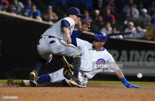 Rafael Ortega of the Chicago Cubs steals second base against Luis Urias of the Milwaukee Brewers during the fourth inning of Game Two of a...