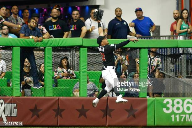 Rafael Ortega of the Miami Marlins reaches for a flyball against the New York Mets in the fourth inning at Marlins Park on August 11 2018 in Miami...
