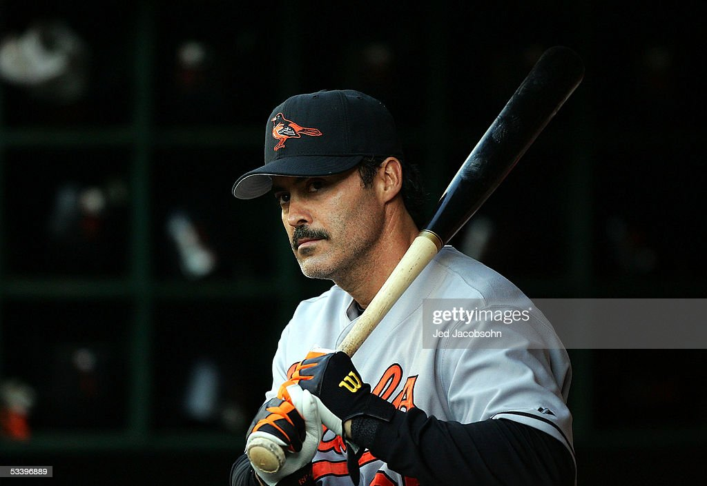 Rafael Palmeiro #25 of the Baltimore Orioles looks on from the dugout during an MLB game against the Oakland Athletics at McAfee Coliseum on August 16, 2005 in Oakland, California.