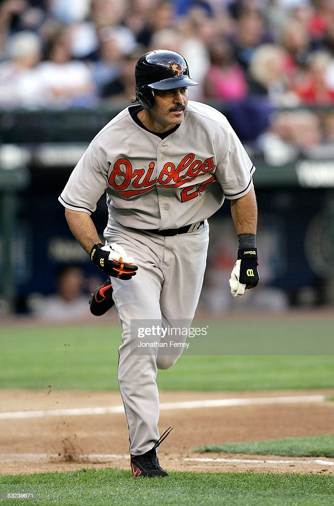 Rafael Palmeiro #25 of the Baltimore Orioles runs to first after hitting his 2,999th career hit in the 4th inning against the Seattle Mariners on July 14, 2005 at Safeco Field in Seattle, Washington.