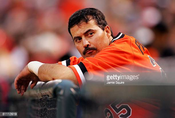 Rafael Palmeiro of the Baltimore Orioles sits in the dugout during the game against the Minnesota Twins at Camden Yards on July 24 2004 in Baltimore...