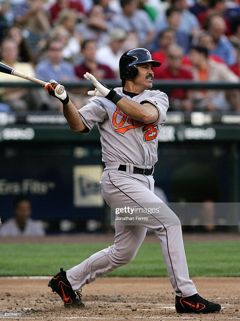 Rafael Palmeiro #25 of the Baltimore Orioles watches his 2,999th career hit in the 4th inning against the Seattle Mariners on July 14, 2005 at Safeco Field in Seattle, Washington.