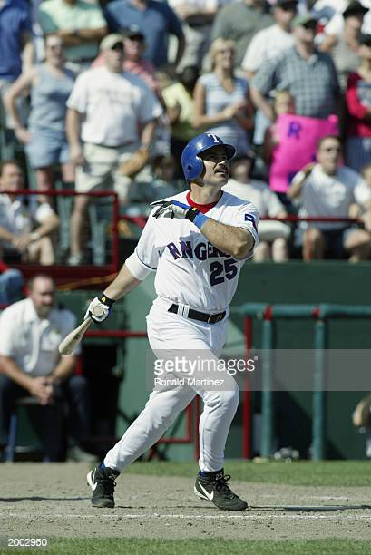 Rafael Palmeiro of the Texas Rangers hits his 500th career home run during the game against the Cleveland Indians at the Ballpark in Arlington on May...