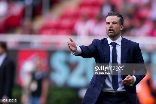 Rafael Puente coach of Lobos gives instructions to his players during the 11th round match between Chivas and Lobos BUAP as part of the Torneo...