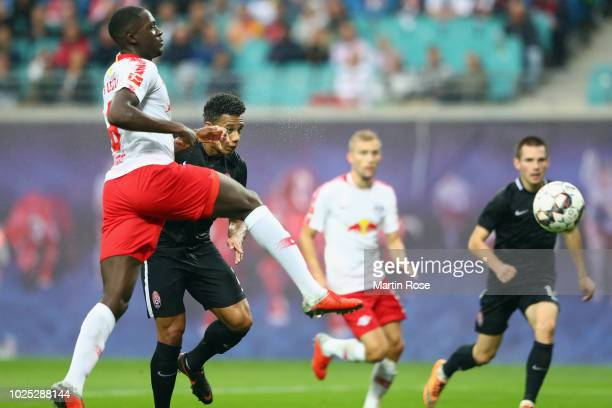 Rafael Ratao of Zorya scores his team's first goal under pressure from Ibrahima Konate of Leipzig during the UEFA Europa League Qualifying PlayOff...