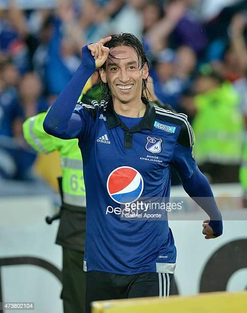 Rafael Robayo of Millonarios celebrates after scoring the third goal of his team during a match between Independiente Santa Fe and Millonarios as...