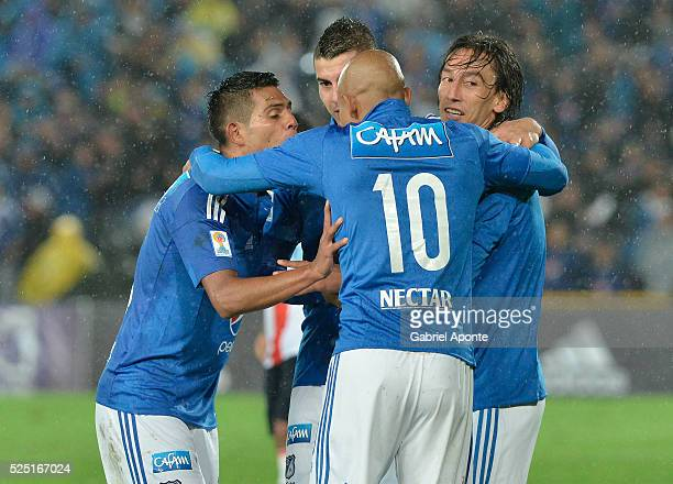 Rafael Robayo of Millonarios celebrates with teammates after scoring during a match between Millonarios and Junior as part of round 15 of Liga Aguila...