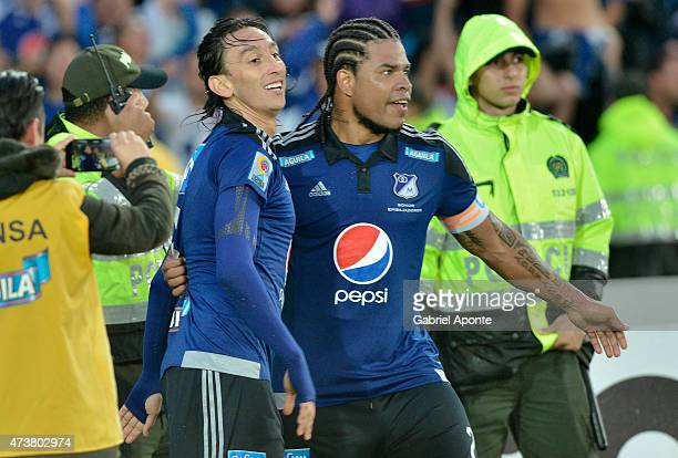 Rafael Robayo of Millonarios celebrates with Wilson Morelo after scoring the third goal of his team during a match between Independiente Santa Fe and...