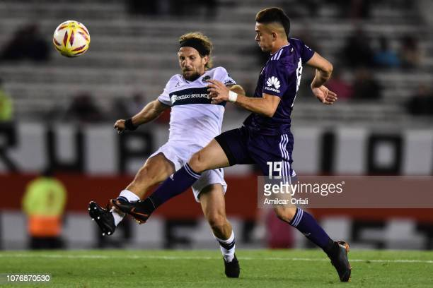 Rafael Santos Borre fights for the ball with Facundo Oreja of Gimnasia during a match between River Plate and Gimnasia y Esgrima La Plata as part of...