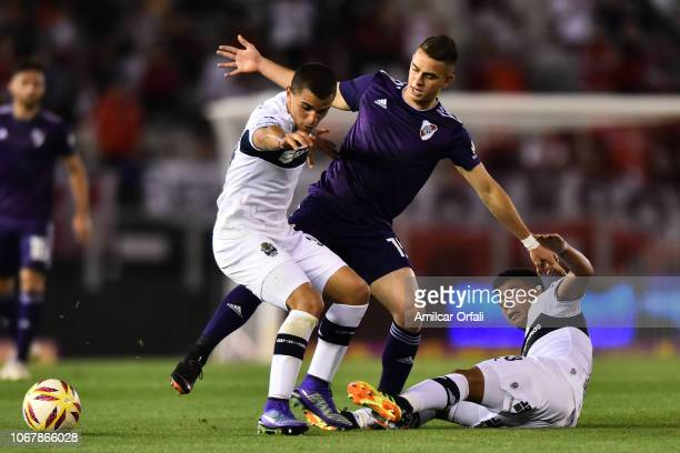Rafael Santos Borre of River and Patricio Monti of Gimnasia fight for the ball during a match between River Plate and Gimnasia y Esgrima La Plata as...