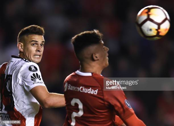 Rafael Santos Borre of River Plate and Alan Franco of Independiente compete for the ball during a quarter final first leg match between Independiente...