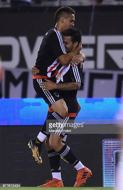 Rafael Santos Borre of River Plate celebrates with Ignacio Scocco after scoring the first goal of his team during a match between River and Union as...