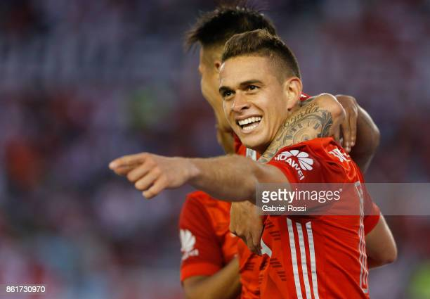 Rafael Santos Borre of River Plate celebrates with teammate Carlos Auzqui after scoring the second goal of his team during a match between River...