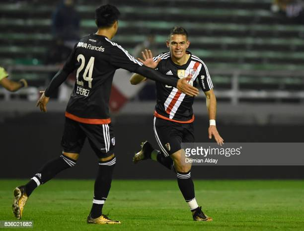 Rafael Santos Borre of River Plate celebrates with teammate Enzo Perez after scoring the fourth goal of his team during a match between River Plate...