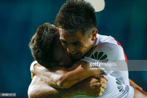 Rafael Santos Borre of River Plate celebrates with teammate Gonzalo Martinez after scoring the first goal of his team during a match between Racing...